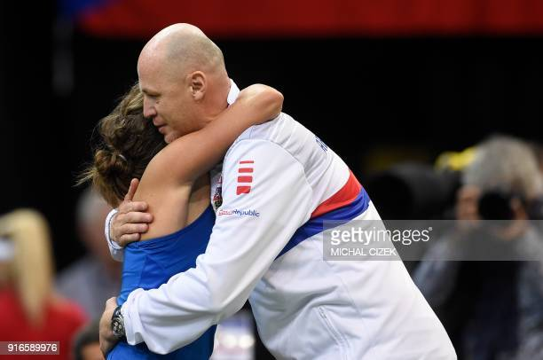 Czech Barbora Strycova celebrates with captain of Czech Fed Cup team Petr Pala after she won her match against Swiss Belinda Bencic in first round of...