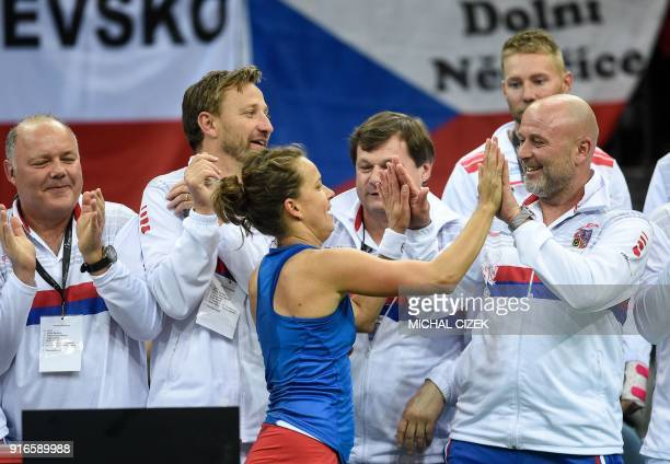 Czech Barbora Strycova celebrates with members of Czech Fed Cup team after she won her match against Swiss Belinda Bencic in the first round of the...