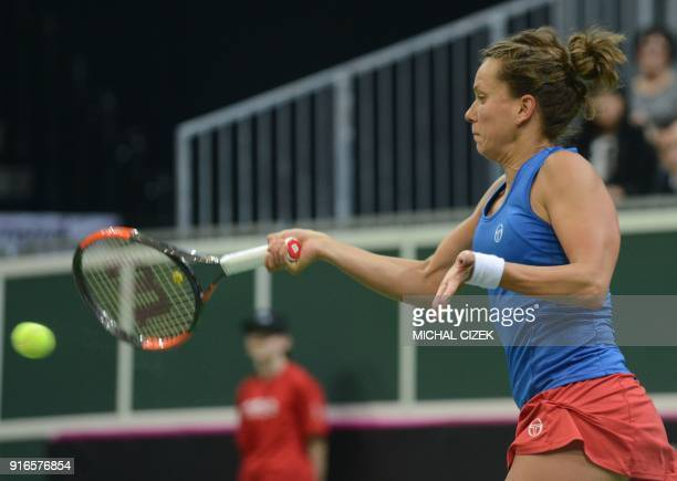 Czech Barbora Strycova returns the ball to Swiss Belinda Bencic in the first round of the International Tennis Federation Fed Cup match between Czech...
