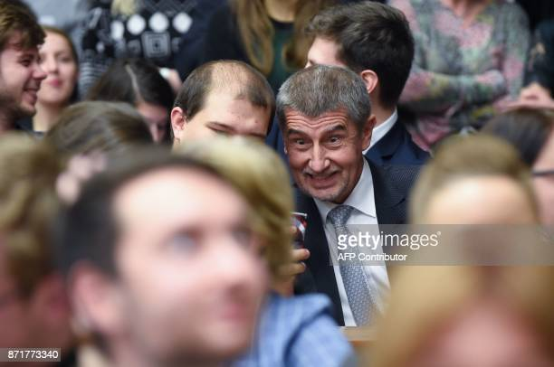 Czech billionaire and leader of the ANO Party Andrej Babis poses for a selfie with a supporter as he arrives for a preelection debate on November 8...