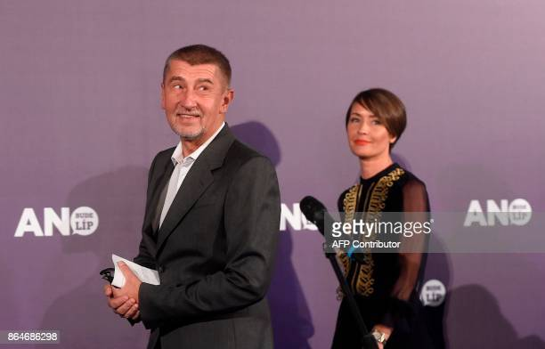 Czech billionaire Andrej Babis chairman of the ANO movement and ANO movement speaker Lucie Kubovicova walk on the stage at ANO headquarter after...