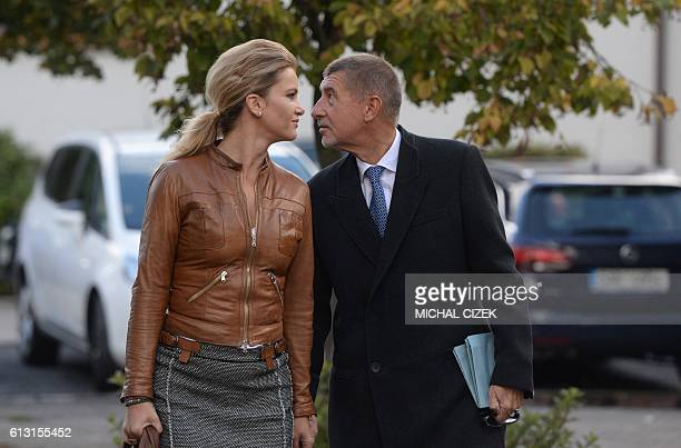 Czech billionaire Andrej Babis chairman of the ANO movement and his wife Monika arrive at a polling station in Prague during the twoday regional and...