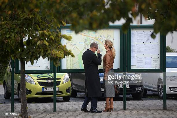 Czech billionaire Andrej Babis chairman of the ANO movement and his wife Monika wait for the opening of a polling station in Prague during the twoday...