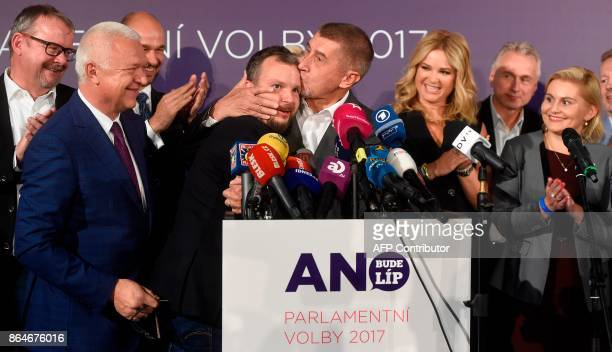 Czech billionaire Andrej Babis chairman of the ANO movement kisses Marek Prchal PR manager of ANO for social media at ANO headquarter after Czech...