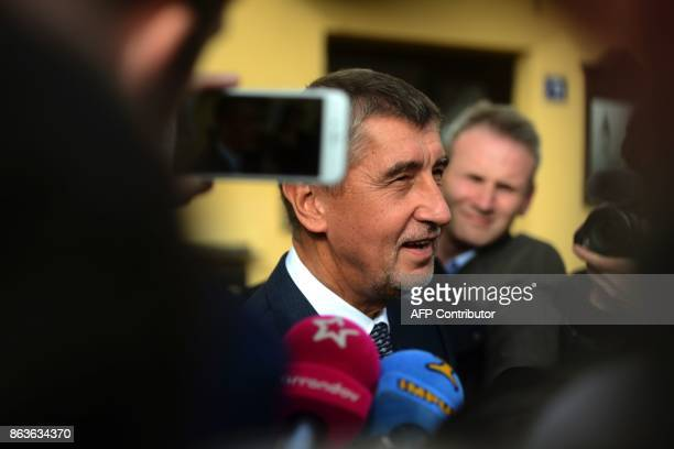 Czech billionaire Andrej Babis chairman of the ANO movement talks to the media after voting at a polling station during the first day of the Czech...