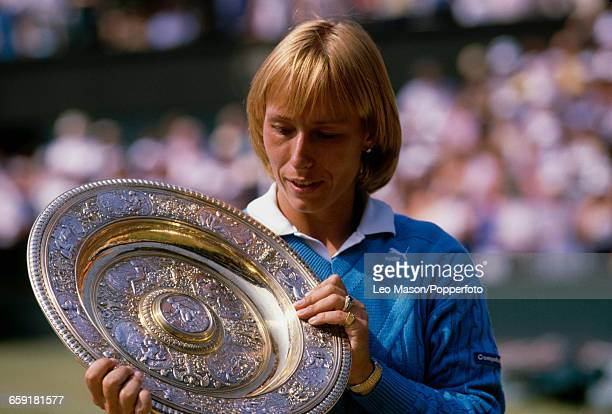 Czech born American tennis player Martina Navratilova holds the Venus Rosewater Dish trophy in the air after winning the final of the Ladies' Singles...