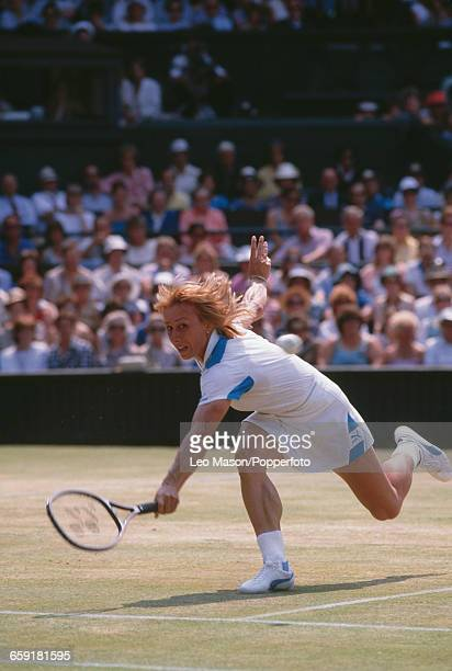 Czech born American tennis player Martina Navratilova pictured in action competing to progress to reach and win the final of the Ladies' Singles...