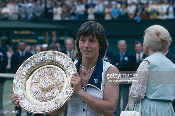 Czech born American tennis player Martina Navratilova pictured holding the Venus Rosewater Dish trophy after defeating Chris Evert to win the final...