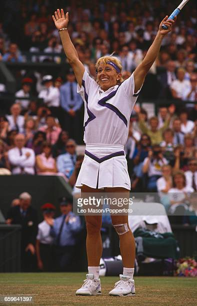 Czech born American tennis player Martina Navratilova raises her arms in the air in celebration after winning the final of the Women's Singles...