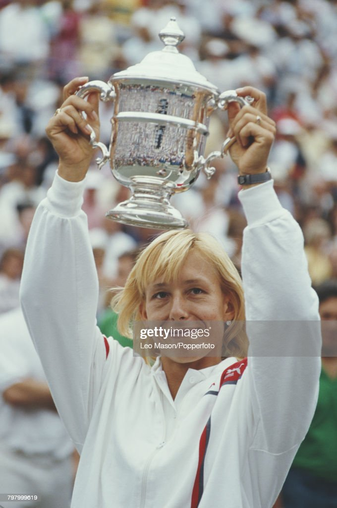 Czech born American tennis player Martina Navratilova raises the trophy in the air in celebration after winning the final of the 1986 US Open Women's Singles tennis tournament against Helena Sukova of Czechoslovakia, 6-3, 6-2 at the USTA National Tennis Center at Flushing Meadows in New York on 7th September 1986.