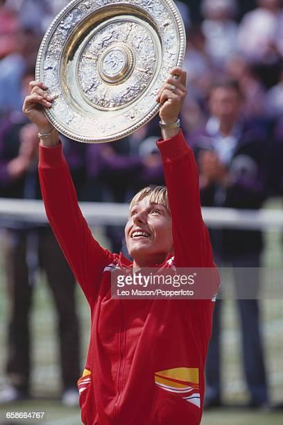 Czech born American tennis player Martina Navratilova raises the Venus Rosewater Dish trophy in the air after winning the final of the Women's...