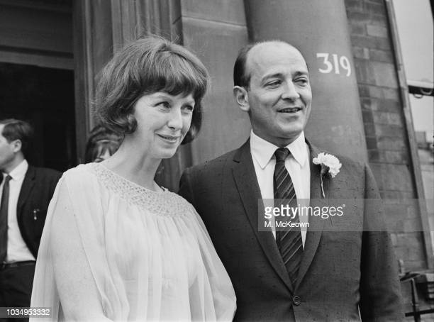 Czech born British filmmaker Karel Reisz pictured with his wife American actress Betsy Blair outside a register office on their wedding day in London...