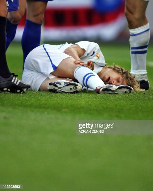 Czech captain Pavel Nedved lies on the ground injured, 01 July 2004 at Dragao stadium in Porto during the Euro 2004 semi-final football match between...