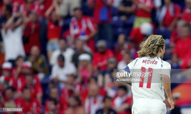 Czech captain Pavel Nedved walks off the pitch after picking up an injury 01 July 2004 during their European Nations championship semifinal football...
