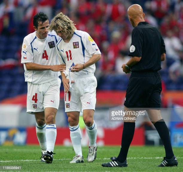 Czech captain Pavel Nedved walks off the pitch with Tomas Galasek after picking up an injury, 01 July 2004 during the European Nations championship...