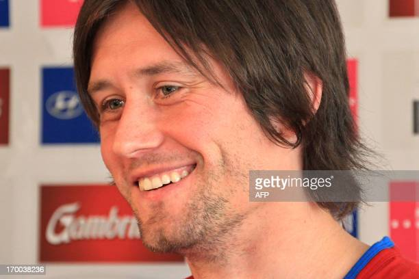 Czech captain Tomas Rosicky smiles during a press conference on June 6 2013 in Prague ahead of the qualification World Cup 2014 football match...