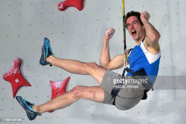 Czech climber and quadruple World Champion Adam Ondra reacts as he competes in the Men Speed Qualification event during the Olympic Climbing...