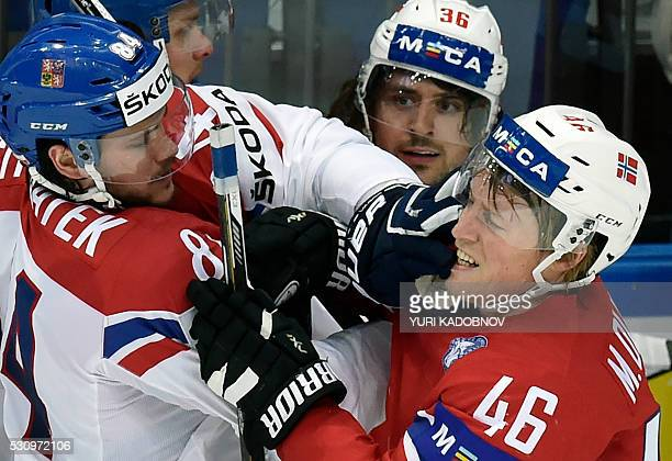 Czech defender Tomas Kundratek fights with Norway's forward Mathis Olimb during the group A preliminary round game Czech Republic vs Norway at the...