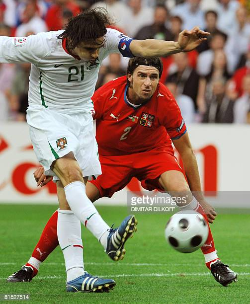 Czech defender Zdenek Grygera watches as Portuguese forward Nuno Gomes kicks the ball during the Euro 2008 Championships Group A football match Czech...
