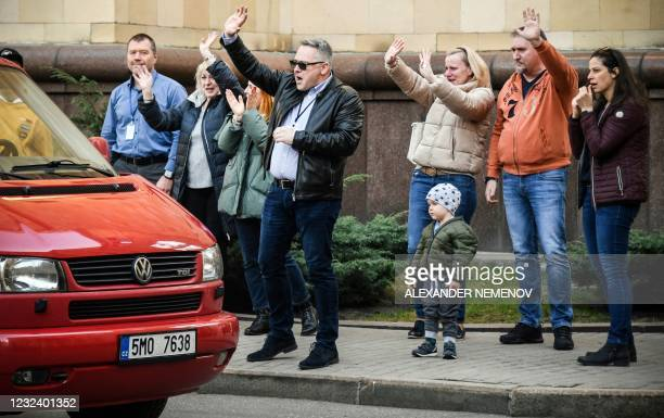 Czech diplomats and their family members leave the grounds of the country's embassy in Moscow on April 19, 2021. - Russia on April 18, 2021 announced...