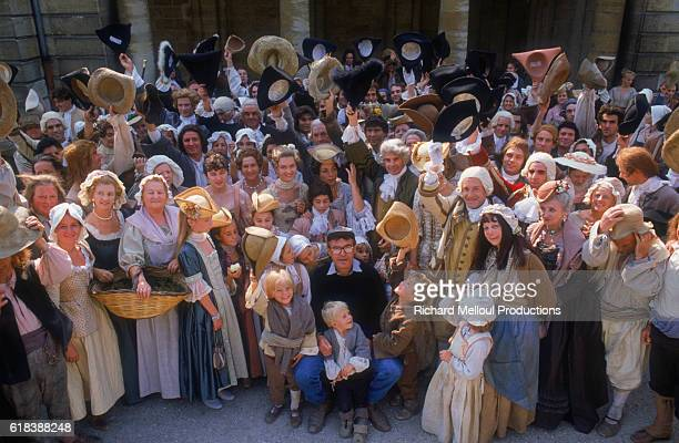 Czech director Milos Forman poses with some of the cast of his 1989 film Valmont on the set in Bordeaux The film is set in 18th century France and...