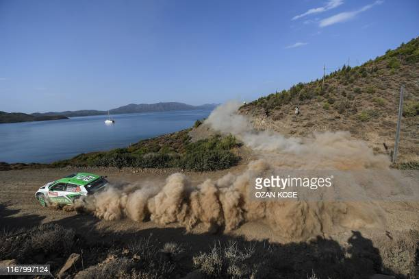 Czech driver Jan Kopecky and his co-driver Pavel Dresler steer their Skoda Fabia R5 during the third day of the 2019 FIA World Rally Championship, at...