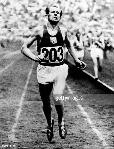 Czech Emil Zatopek crosses victoriously the finish line of the 10 000 metres in 1948 London Olympic Games During his career Emil Zatopek fourtime...