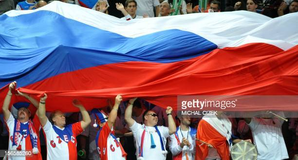 Czech fans covered in Czech flag cheer after Radek Stepanek and Tomas Berdych won thier double tennis match against Spanish tennis players Marc Lopez...