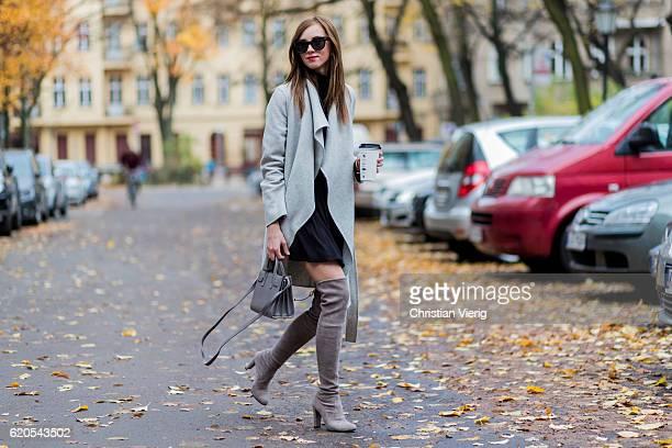 Czech fashion blogger Barbora Ondrackova holding a coffee to go wearing a black Proenza Schouler tutleneck sweater a black Topshop skirt a grey Zara...