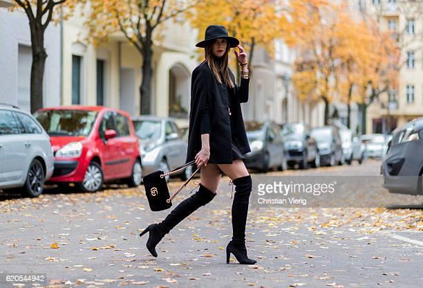Czech fashion blogger Barbora Ondrackova wearing a black Proenza Schouler turtleneck sweater, a black Topshop Skirt, a black Gucci belt, a black...