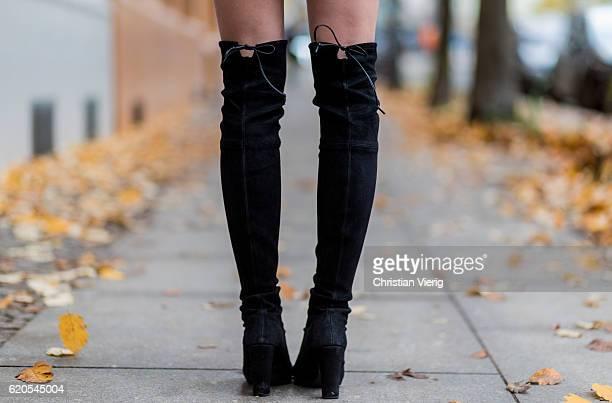 Czech fashion blogger Barbora Ondrackova wearing black Stuart Weitzman boots overknees on November 2, 2016 in Berlin, Germany.