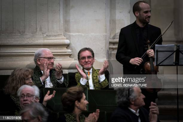 Czech former dancer and choreographer Jiri Kylian applauds after musicians performed during his induction ceremony at the Academy of Fine Arts part...