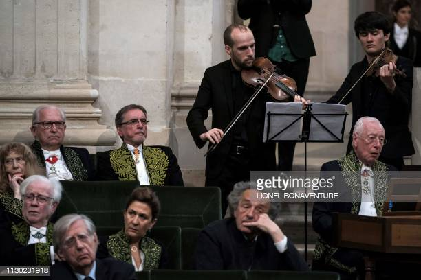 Czech former dancer and choreographer Jiri Kylian listens to musicians performing during his induction ceremony at the Academy of Fine Arts part of...