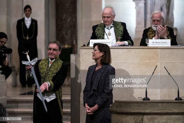 Czech former dancer and choreographer Jiri Kylian poses with a sword received by Princess Caroline of Hanover during his induction ceremony at the...