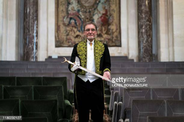 Czech former dancer and choreographer Jiri Kylian poses with his sword after being elected as foreign associate member of the Academy of Fine Arts...