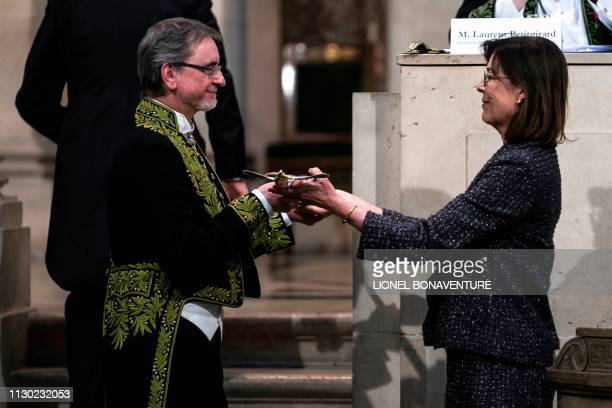 Czech former dancer and choreographer Jiri Kylian receives a sword by Princess Caroline of Hanover during his induction ceremony at the Academy of...