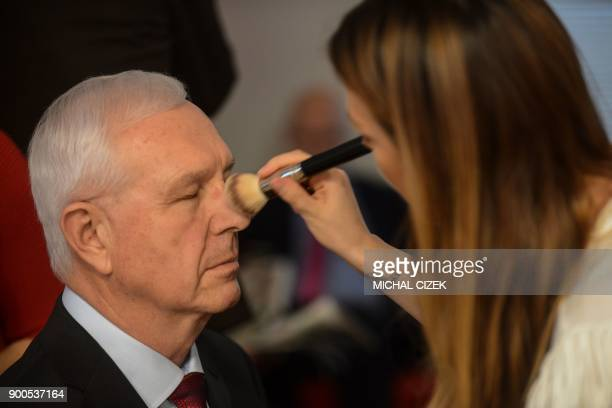 Czech former Science Academy head and candidate for the upcoming presidential election Jiri Drahos has his face made up on a TV set before a...