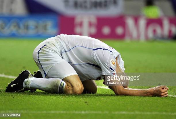 Czech forward Jan Koller reacts after missing a chance to score 01 July 2004 at Dragao stadium in Porto during the Euro 2004 semi final match between...