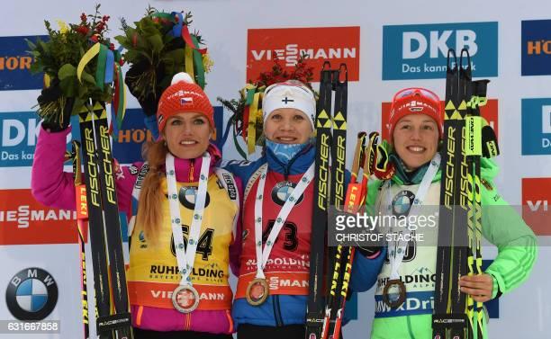 Czech Gabriela Koukalova, Finnish Kaisa Makarainen and German Laura Dahlmeier pose with their medals on the podium of the winner ceremony of the...