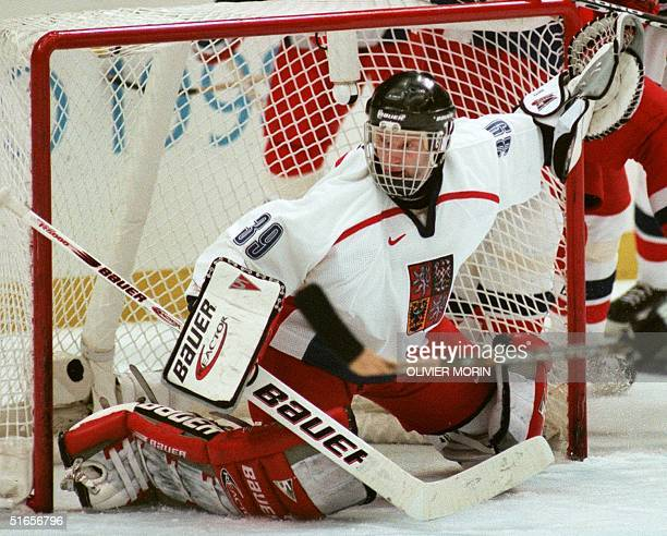 Czech goalkeeper Dominik Hasek protects his goal during the Olympic men's final at the Big Hat in Nagano 22 February. The Czechs won 1-0 to win their...