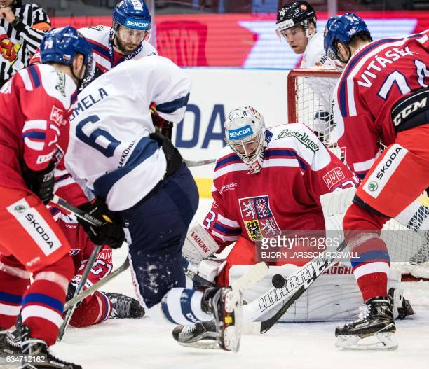 Czech goalkeeper Pavel Francouz stops a shot from Finland's Antti Suomela during the Finland vs the Czech Republic ice hockey match in the Sweden...