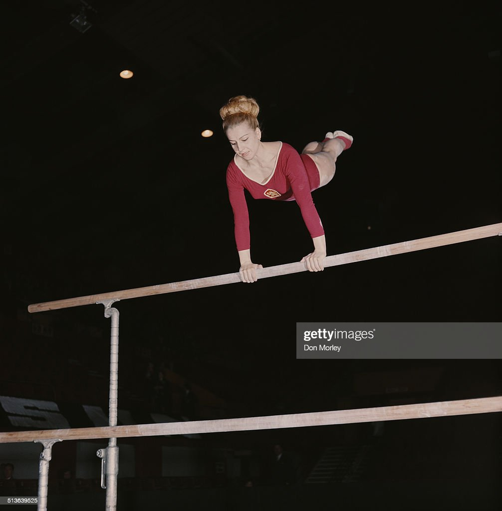 Czech gymnast and seven time Olympic Gold medallist Vera Caslavska competes on the uneven bars 1st June1968 in London, Great Britain.