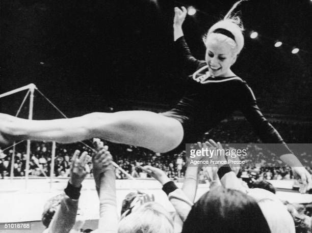 Czech gymnast Vera Caslavska is thrown in the air by her teammates after winning an event Mexico City Mexico October 24 1968 Caslavska won four...