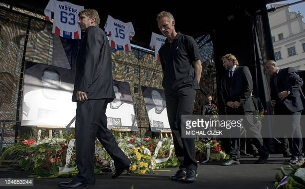 Czech Ice hockey goalkeeper Dominik Hasek and unidentified members of Czech ice hockey association pay tribute to Josef Vasicek Jan Marek and Karel...