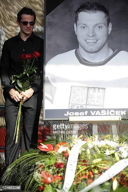 Czech Ice hockey player Patrik Elias pays tribute to his teammates Josef Vasicek Jan Marek and Karel Rachunek who died during the plane disaster of...