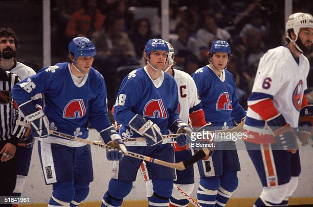 Czech ice hockey playing brothers Peter Stastny Marian Stastny and Anton Stastny of the Quebec Nordiques on the ice in a game against the New York...
