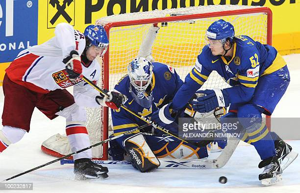 Czech Jaromir Jagr attacks Sweden goalie Jonas Gustavsson of NHL's Toronto Maple Leafs as Sweden's Jonathan Ericsson of NHL's Detroit Red Wings tries...