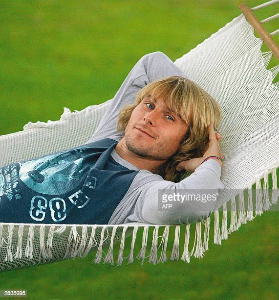 Czech Juventus midfielder Pavel Nedved poses 01 September 2003 in the garden of his Turin's house. English Premiership leaders Chelsea are ready to...