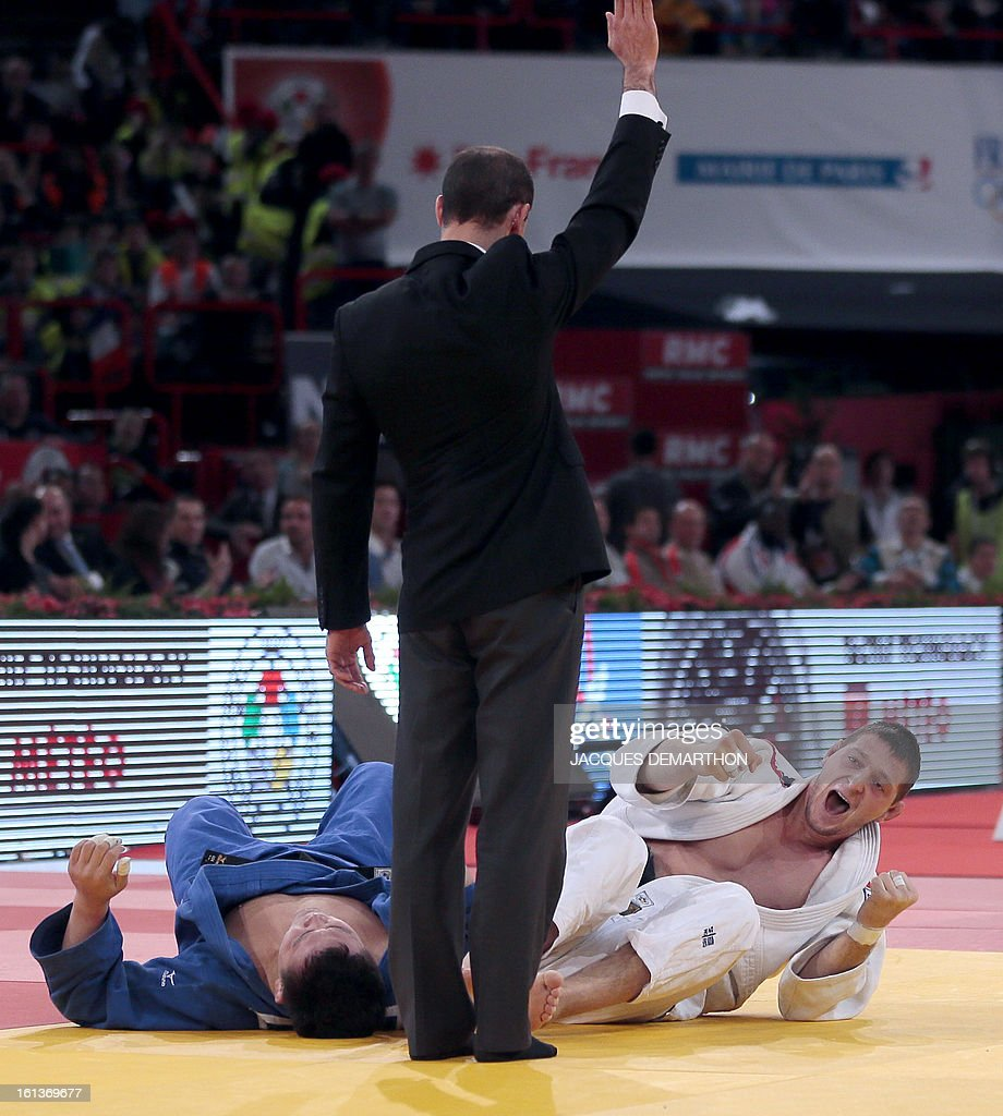 Czech Lukas Krpalek (white) celebrates azs he wins against Mongolia's Temuulen Battulga during the Men -100kg contest final match of the Paris' Judo Grand Slam tournament on february 10, 2013 in Paris.