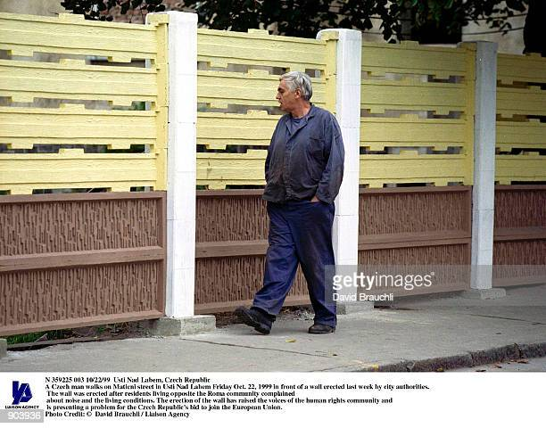 A Czech man walks on Maticni street in Usti Nad Labem Friday Oct 22 1999 in front of a wall erected last week by city authorities The wall was...